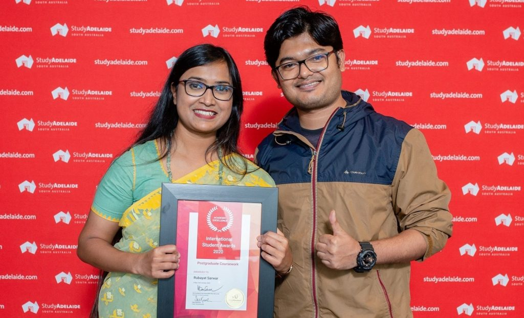 Scholar Rubayat Sarwar from Bangladesh with her husband holding the Award